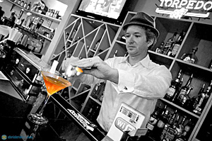 "Jimi Gonzalez mixes a drink at the ""All Booze No Juice"" night at Florida Wine & Spirits."