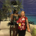 Cockspur Rum booth with beautiful dancer.